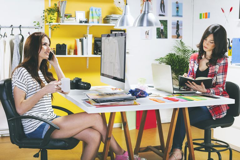 Two bloggers working in office
