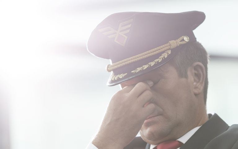 Exhausted pilot at the airport