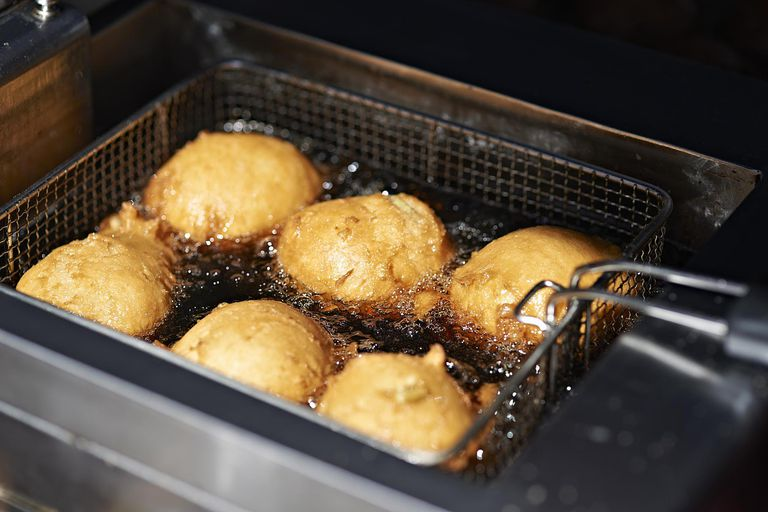 German deepfried donut being cooked