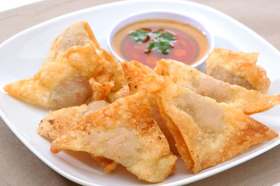 Plate of deep fried wontons with dipping sauce