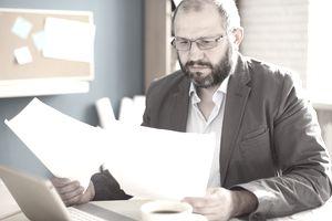 Man looking through resumes
