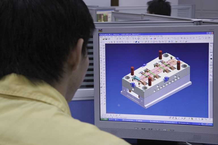 Man looking at computer graphic in computer screen, rear view
