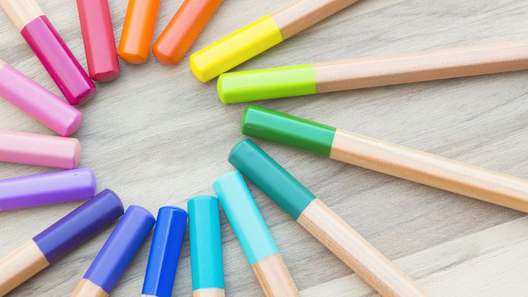 Color wheel symbolized by colored pencils of several hues