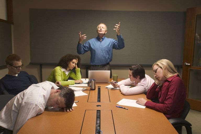 Businessman speaking before inattentive colleagues at meeting