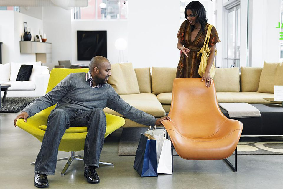 Man and woman shopping for chairs in retail furniture store