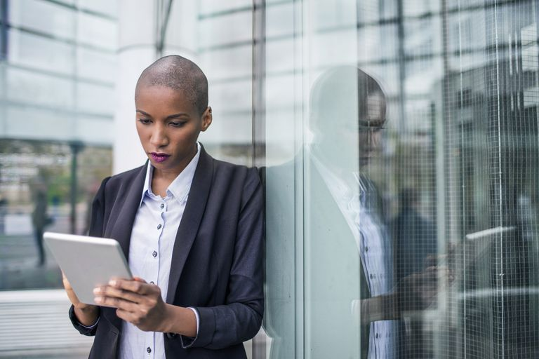 businesswoman looking at tablet