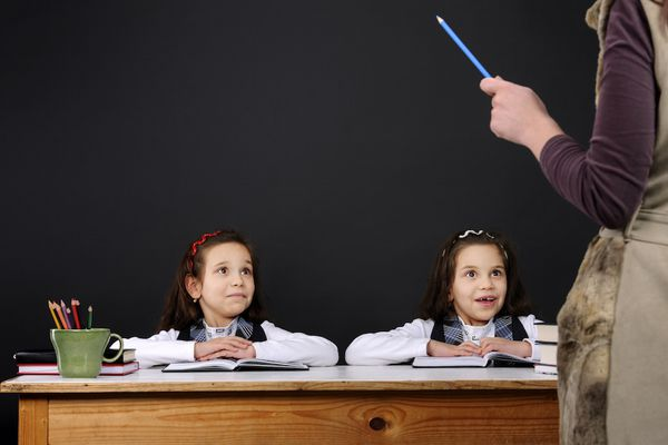twin girls together in classroom