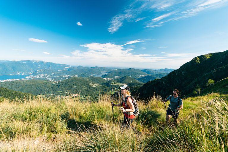Couple walk along mountain ridge