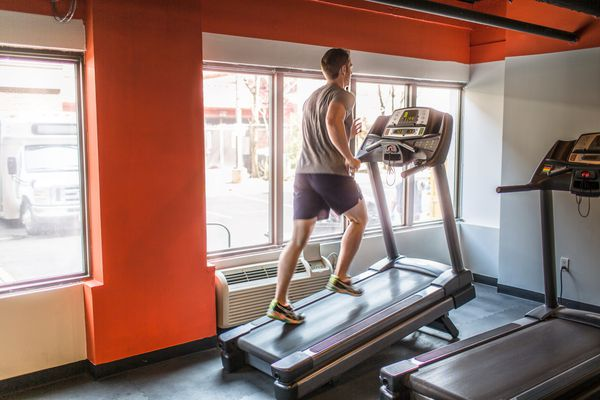 Man running uphill on treadmill