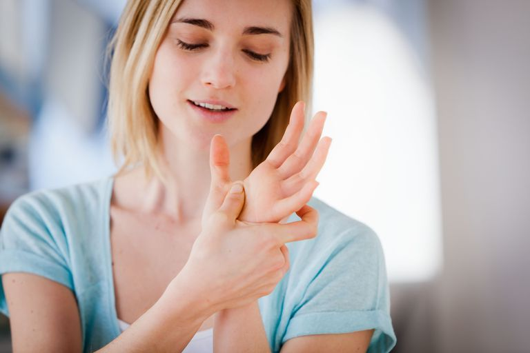 Woman pressing a pressure point on her hand