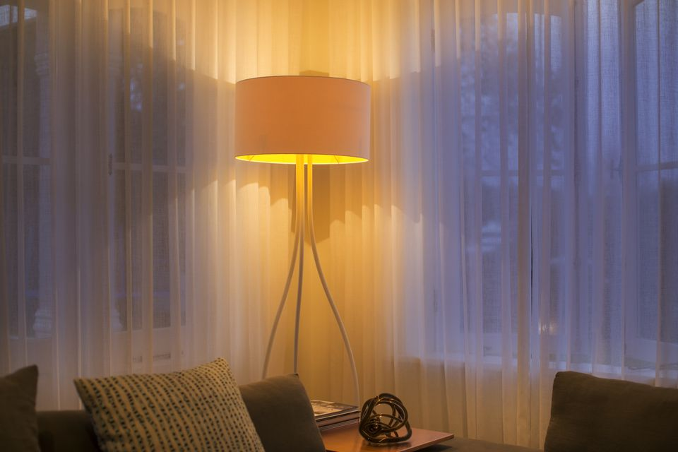 Why you need a lamp shade with examples illuminated floor lamp at window with sheer curtains mozeypictures Choice Image