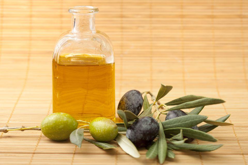Olives and olive oil in bottle