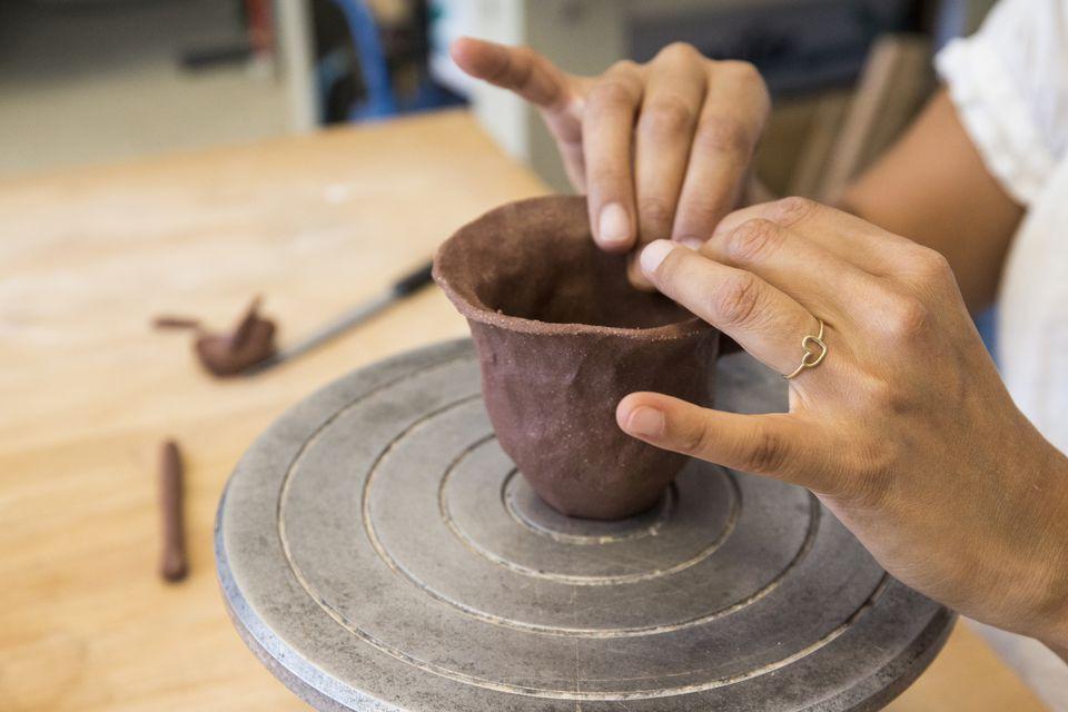 Pinching clay pot