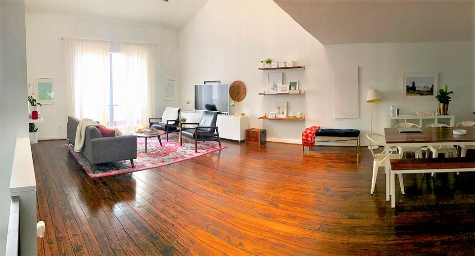 Living Room With Hardwood Flooring Before Makeover