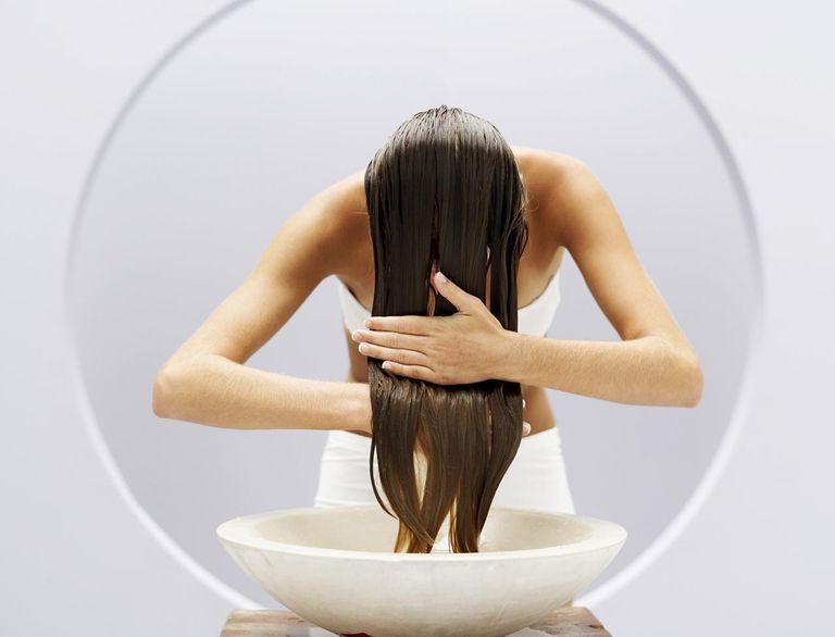 Woman washing her hair in a basin