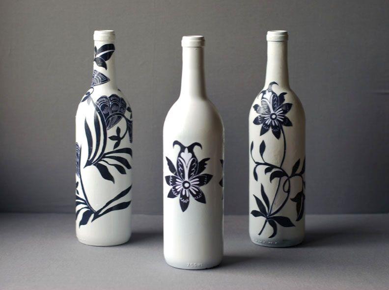 Decoupaged blue and white wine bottles