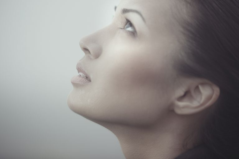 Portrait of woman looking up and praying