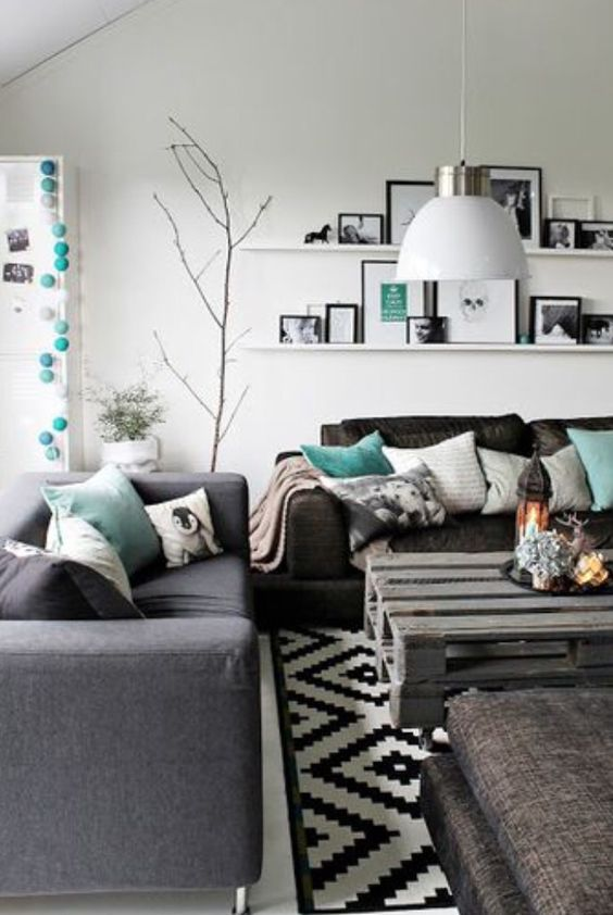 A modern living room with turquoise accents