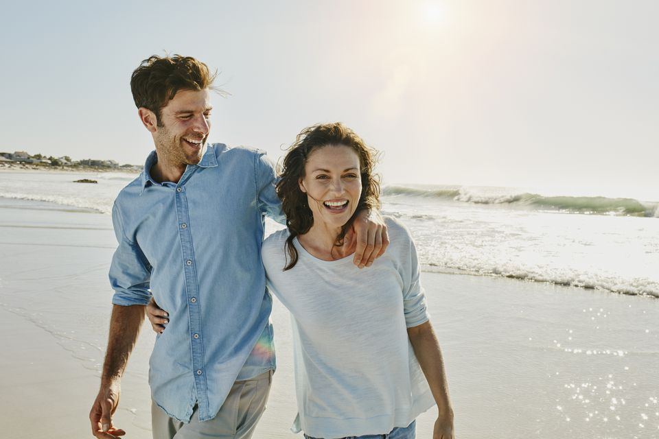 Laughing couple on the beach
