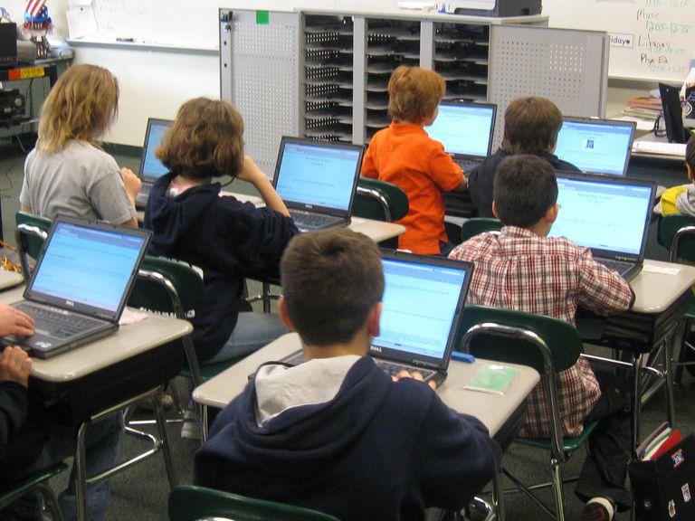classroom of kids on laptops