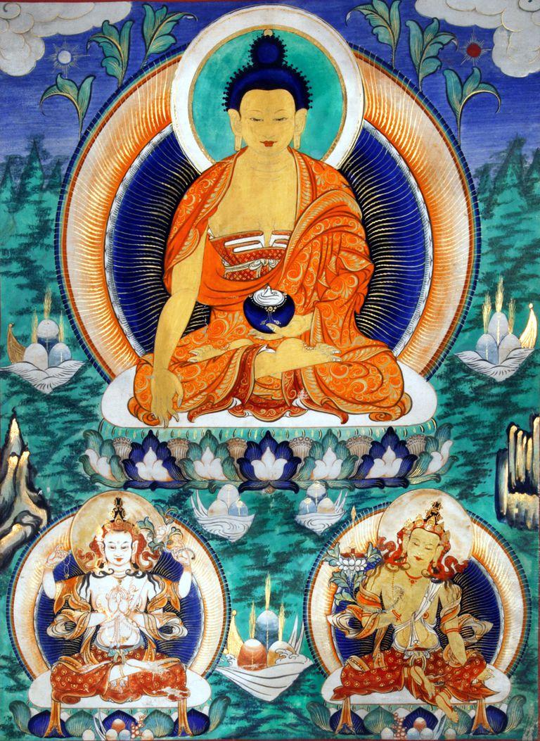 19th Century Mongolian distemper with highlights of gold, depicting Shakyamuni flanked by Chenrezig and Manjushri