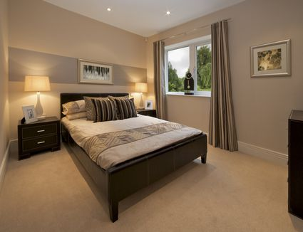 Design tips for using area rugs over carpet for Best carpet for a bedroom