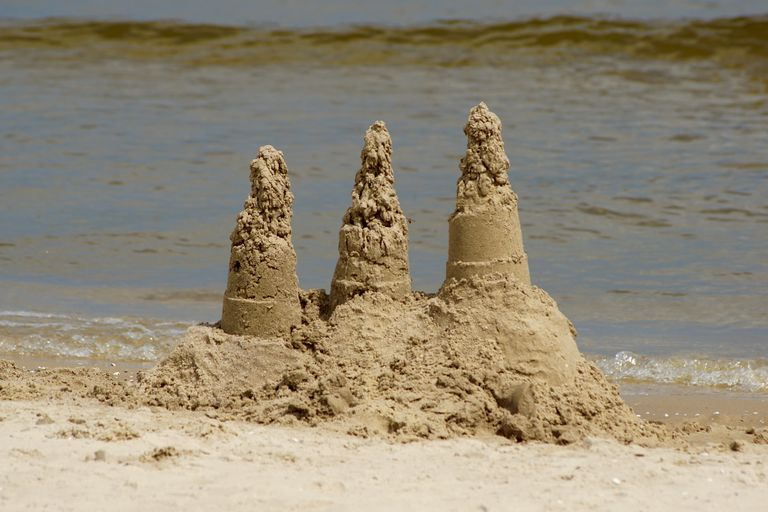 View Of Sand Sculptures Against Sea At Beach