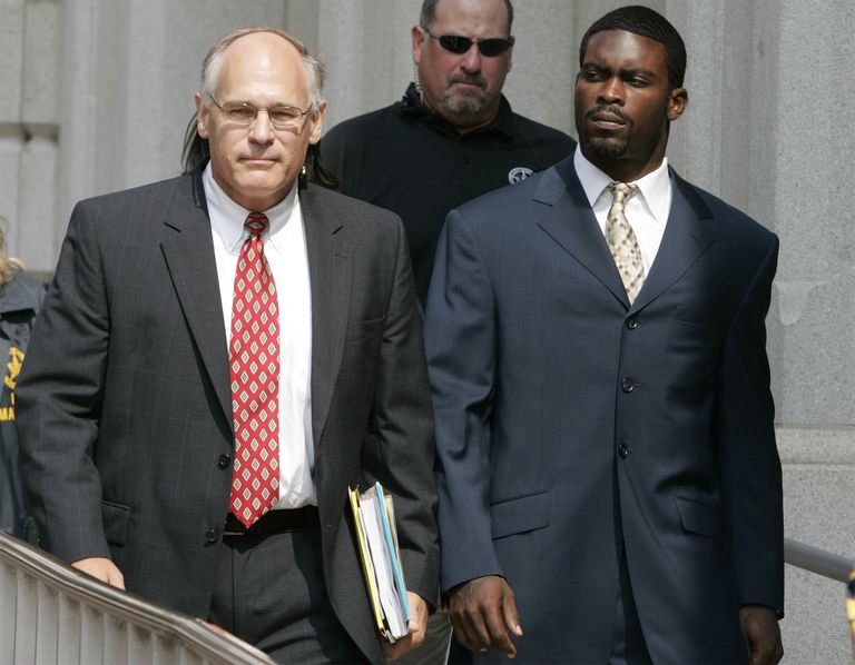 Michael Vick (R) with his attorney Lawrence Woodward