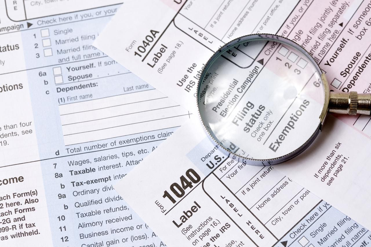 Virginia 529 tax forms - Tax Form And Magnifying Glass
