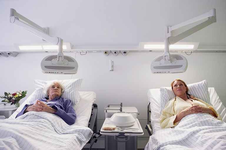 Two patients watching television