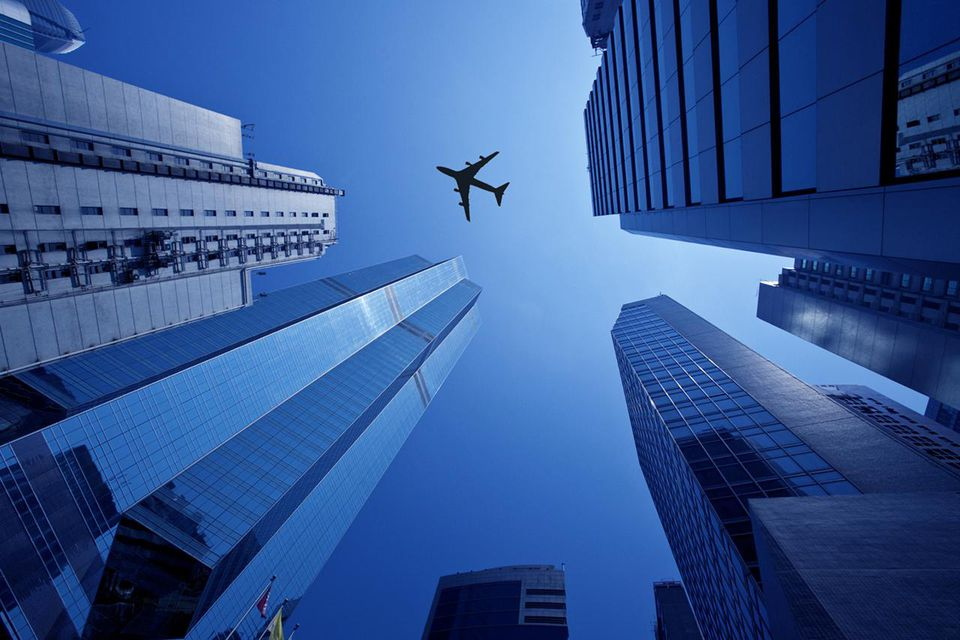 A low flying aircraft above the skyscrapers of the business district of Hong Kong