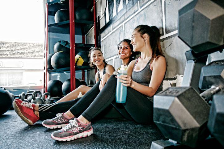 women having conversation at gym