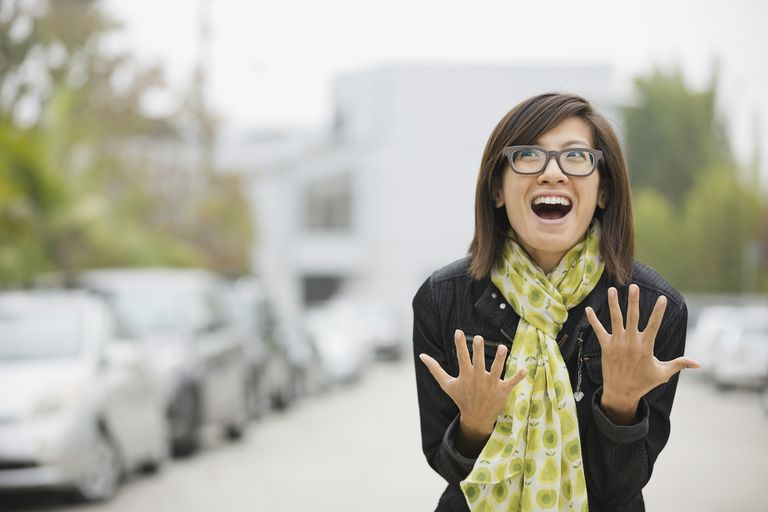 Portrait of an excited woman on the street