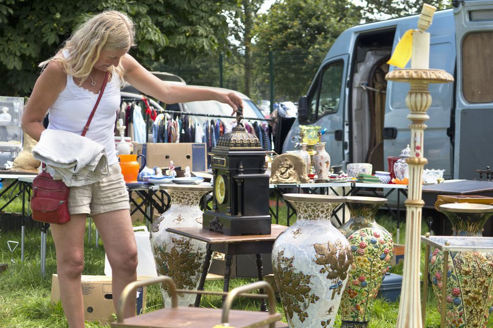 Woman Browsing On Stall At Outdoor Flea Market