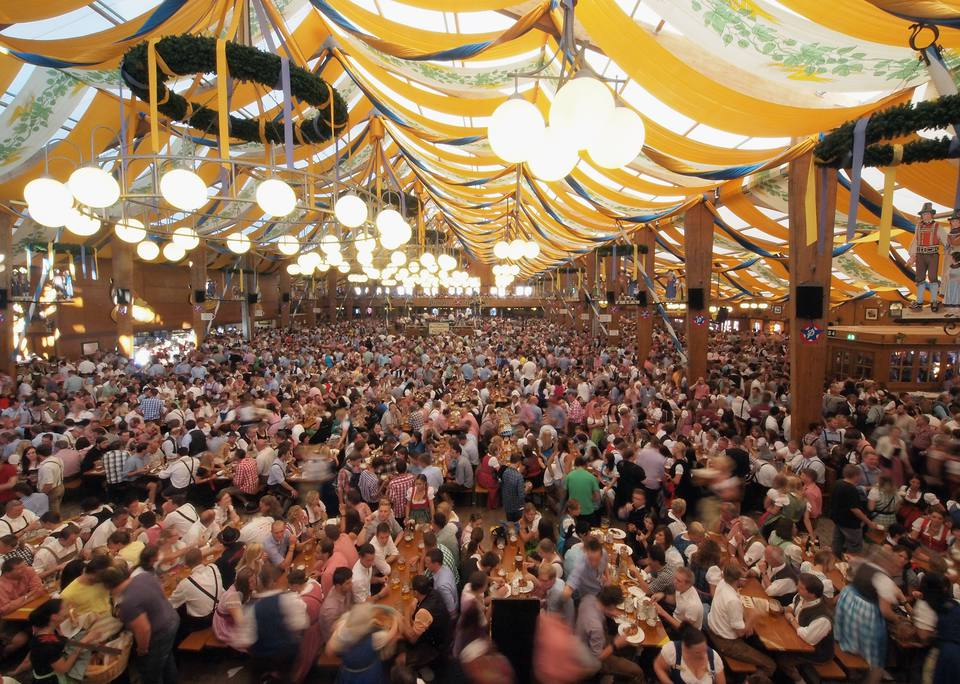 Revellers enjoy themselves as they drink beer at the Braeurosl beer tent during day 7 of Oktoberfest beer festival in Munich