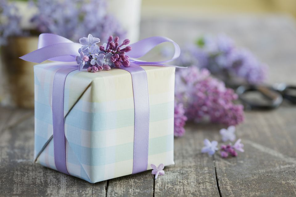 Lilacs around a wrapped gift