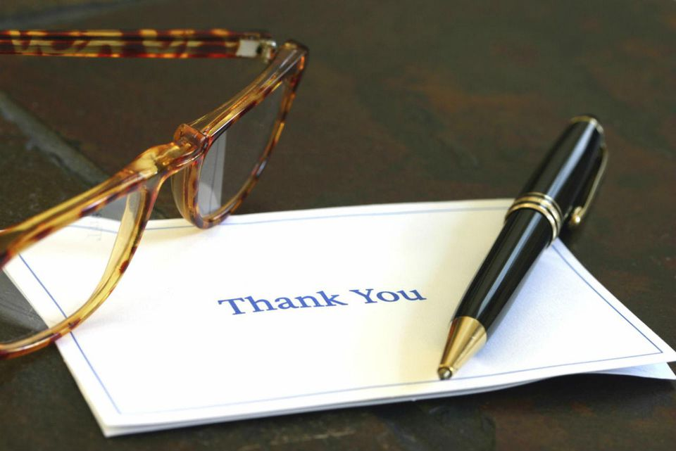 Thank you note, pen, and glasses