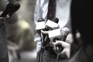 A picture of reporters interviewing someone