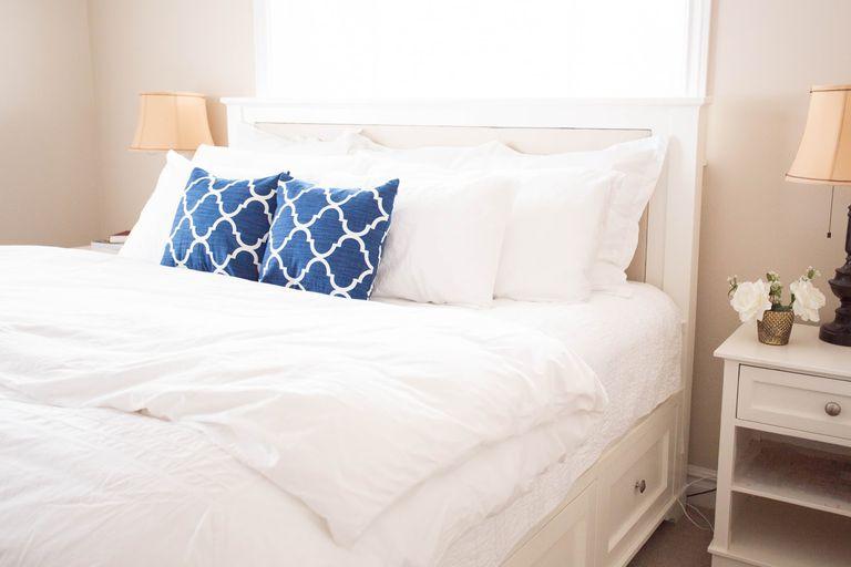 A white DIY storage bed