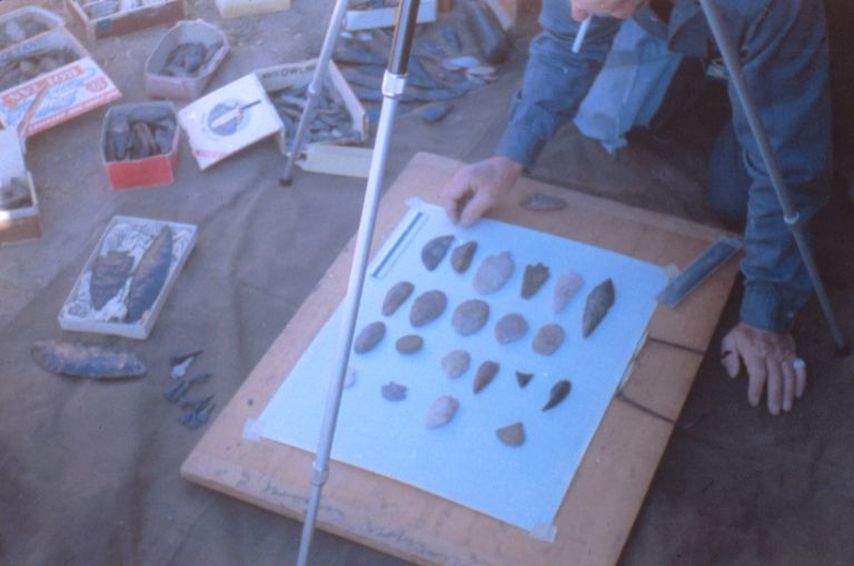 Archaeologist Luther Cressman photographs Reub Long's arrowhead collection in Oregon, 1966