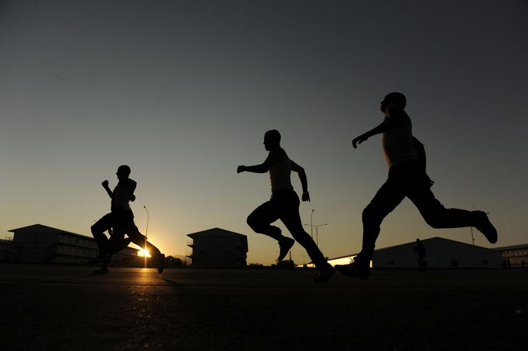 People running at sunset