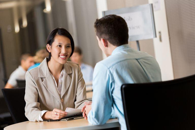 Young Asian businesswoman conducting interviews at job fair