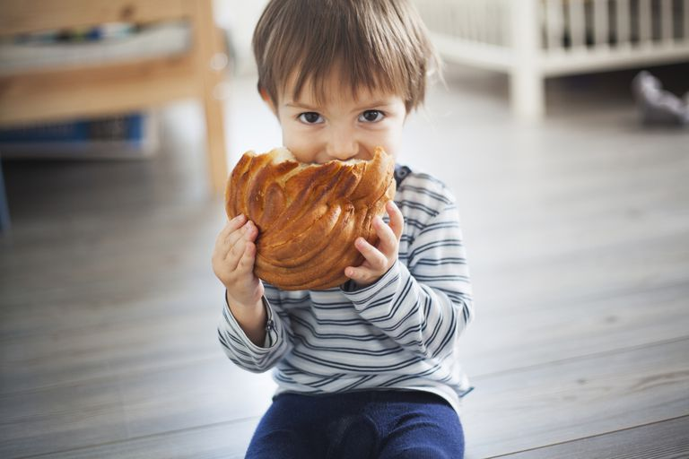 young child with bread