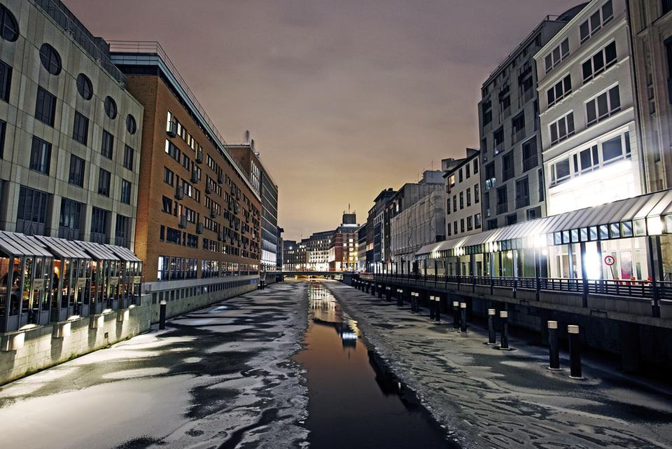 Frozen canal in inner Hamburg at night