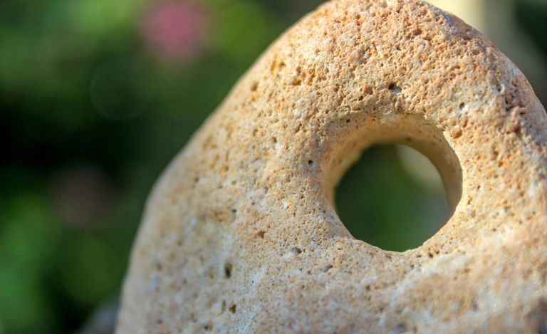 Close-Up Of Hole In Stone