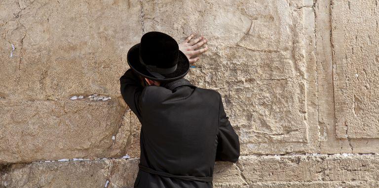 Jewish man praying at Western Wall