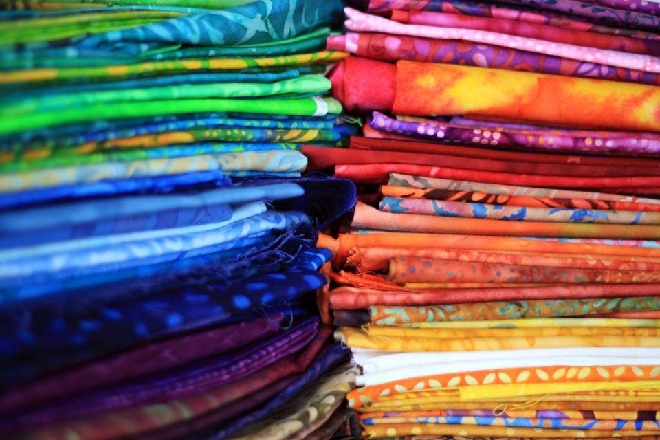 Piles of batik fabric
