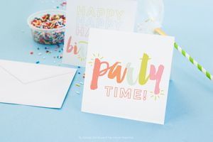 Two birthday cards on a table with sprinkles