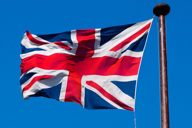 Union Jack flying against blue sky