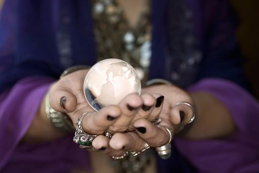 Woman holding crystal ball